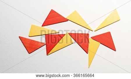 Different Colorful Triangles Wooden On White Background. Geometric Shapes Red, Yellow Colors, Top Vi
