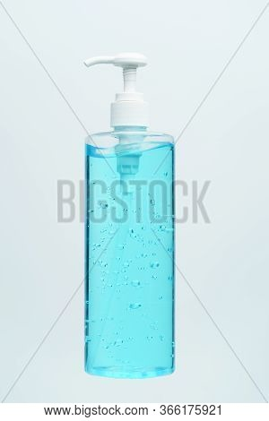 Clear Blue Hand Sanitizer In A Clear Pump Bottle On A White Background.
