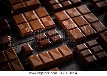 Milk And Hazelnut Chocolate Bars On Black Background