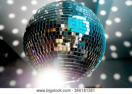 Mirror Ball At A Party With Light Reflections