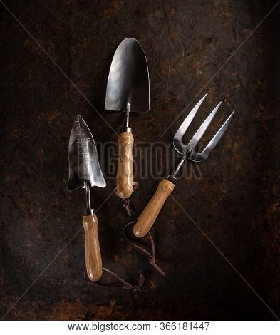 New Gardening Tools On Grungy Dark Background