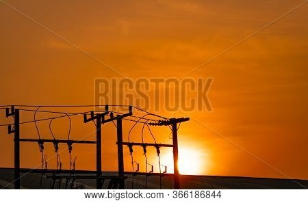 Three-phase Electric Power For Transfer Power By Electrical Grids. High Voltage Electric Poles In Fa