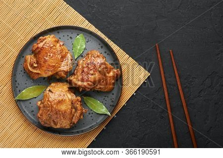 Filipino Chicken Adobo On Dark Gray Plate On Black Slate Backdrop. Chicken Adobo Is Filipino Cuisine
