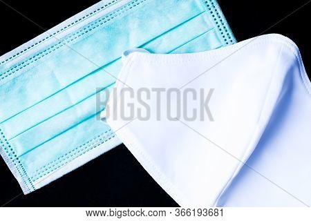 Cloth White Mask And Surgical Mask Isolated On Black Background - For Prevent Dust (pm 2.5), Disease