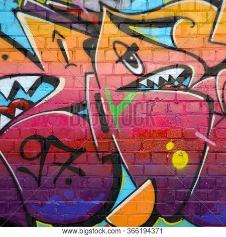 Abstract Colorful Fragment Of Graffiti Paintings On Old Brick Wall. Street Art Composition With Part