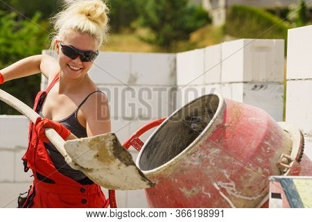 Strong Woman Working With Construction Site