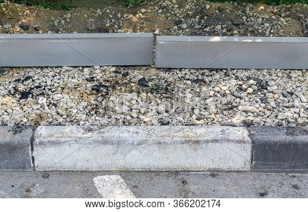 New Curbstones For Extension Of The Pedestrian Walkway Lie On Rubble. Repair Of Roads