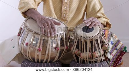 Close-up Of The Hands Of An Indian Musician Drumming On Traditional Tabla Percussion Instrument