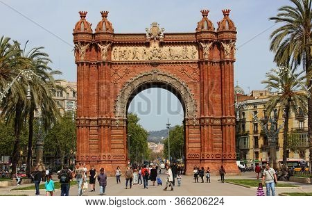 Barcelona, Catalonia, Spain - April 15, 2015: The Arc de Triomf (Triumphal Arch) in Barcelona. Built by architect Josep Vilaseca as the main access gate for the 1888 World Fair.