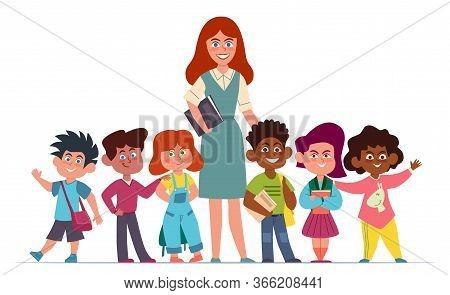 Teacher With Children. Happy Multiethnic Group Of Girls And Boys Schoolchildren And Woman Pedagogue