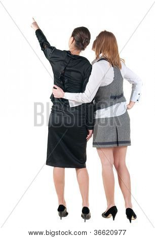 back view of business team. two young  business woman pointing.  Rear view people collection.  backside view of person.  Isolated over white background.
