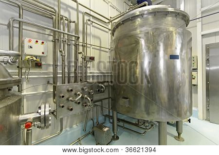 Dairy factory with milk pasteurization tank and pipes poster