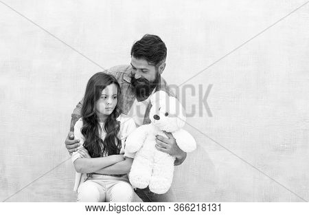 Look At This Toy. Father Show Soft Toy To Little Daughter. Upset Child And Bearded Man With Toy Bear