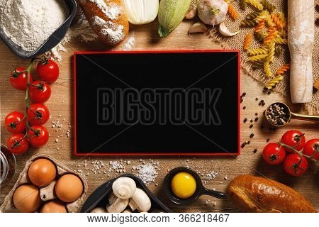 Top View Board And Vegetables With On Kitchen Table. Cooking Classes Concept. With Copy Space.