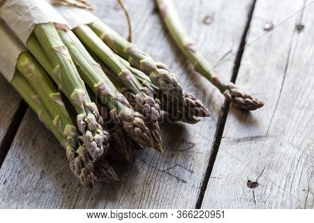 Green Asparagus. Bunches Of Green Asparagus On A Grey Wooden Rustic Background