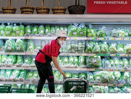 Bangkok, Thailand - May 02: Unnamed Staff Fill Up Refrigerated Shelves With Fresh Produce In Makro S