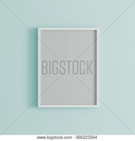 Blank Frame On Light Blue Wall Mock Up, Vertical Black Poster Frame On Wall,  Picture Frame Isolated