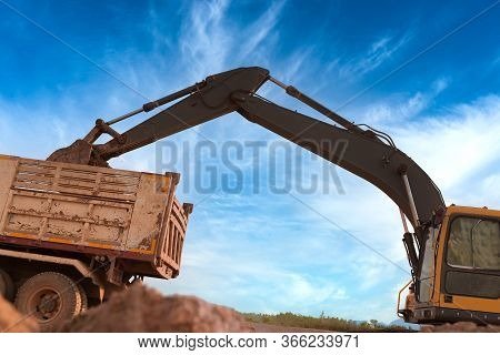 Close Up Details Of Industrial Excavator Working On Construction Sitelarge Backhoe Or Digger With Ra