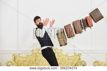 Baggage Insurance Concept. Porter, Butler Careless, Dropping Pile Of Vintage Suitcases. Man With Bea