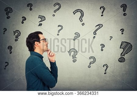 Businessman Keeps Hand Under Chin, Thoughtful Gesture, Looking Ahead Focused, Thinking Answers To Di