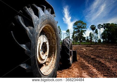 The Tractor Wheels On The Huge Field, A Farmer Riding A Tractor, A Tractor Working In A Field Agricu
