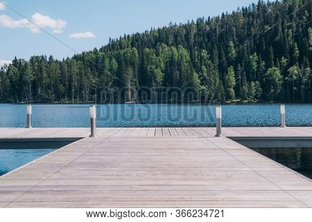 Close-up Of Empty Wood Pier On Beautiful Scenic Lake