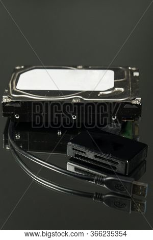 Universal Card Reader And Hard Drive Isolated On Black Background