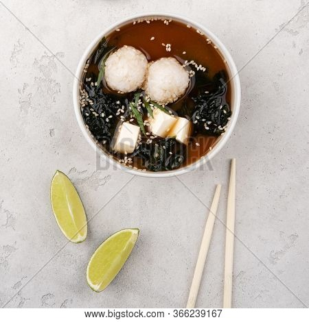 Miso Soup With Rice, Tofu Cheese And Wakame Seaweed. A Traditional Japanese Dish. Food Delivery.