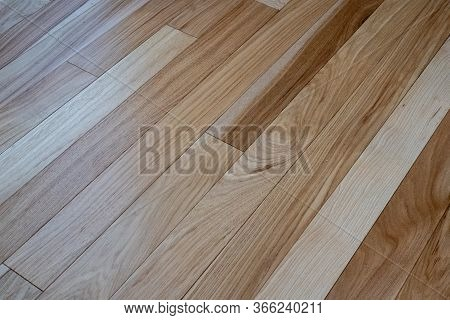 Beautiful Natural Hickory Wooden Floor Panels From An Angled View. Solid Wood Boards With Varied Gra