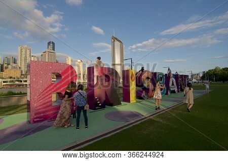 Brisbane, Qld, Australia - 29th February 2020 : Tourist In Front Of The Brisbane Sign Monument With