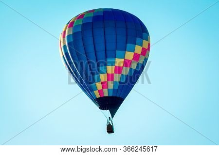 Hot Air Balloon Flying By In A Clear Blue Sky During An Airshow In Battle Creek Michigan