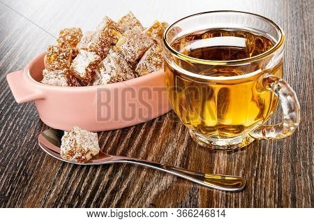 Pink Glass Bowl With Rakhat-lukum, Transparent Cup With Tea, Teaspoon On Dark Wooden Table
