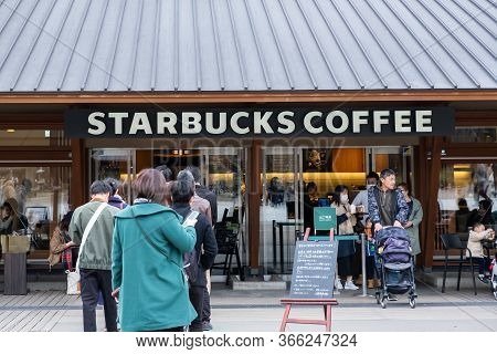 Tokyo, Japan - March 17, 2019:view Of Customers Waited In The Queue At Starbucks Coffee Ueno Onshi P