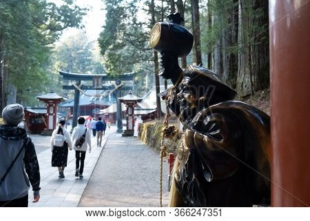 Tochigi, Japan - March 21, 2019: View Of The Gate With The Golden Holy Traveler Sculpture Of Nikko F