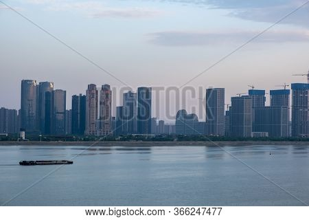 Zhejiang, China - May 21, 2019: View Of Hangzhou With Modern Buildings And Their Reflection, Is The