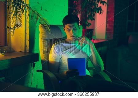 Serious. Cinematic Portrait Of Stylish Man In Neon Lighted Interior. Toned Like Cinema Effects, Brig