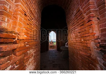 Myanmar Travel Images Of Distant Temples And Stupa Viewed Through Long Arched Red Brick Corridor Wit
