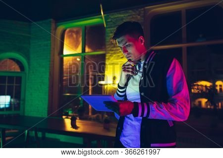 Thinking. Cinematic Portrait Of Stylish Man In Neon Lighted Interior. Toned Like Cinema Effects, Bri
