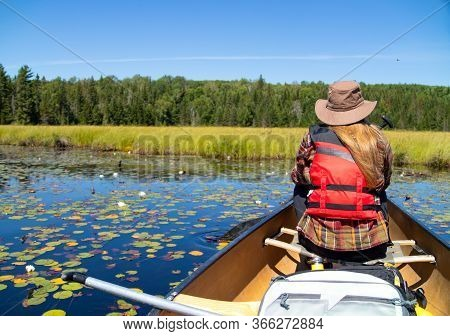 Outdoors Woman In Canoe On Canadian Lake