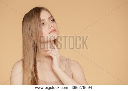Beautiful Portrait Young Woman On Beige Isolated Background, Skin And Hair Care. Beauty Face Concept