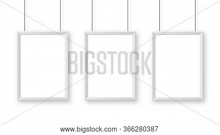 Realistic Hanging On A Wall White Blank Picture Frame. Modern Poster Mockup. Empty Photo Frame. Vect