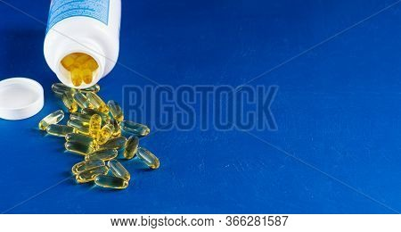 Fish Oil Gel Capsule With Bottle. It Containing Omega-3 Polyunsaturated Acid Epa And Dha Enhances He