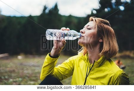 Girl Quenches Thirst After Fitness, Person Drinking Water From Plastic Bottles Relax After Exercisin