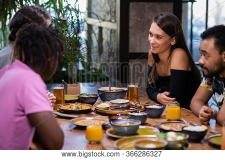 Double Date In A Cafe, Two Multi-ethnic Couples Talking In A Caf