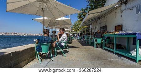 Almada, Portugal - September 07, 2019: People Enjoying The Good Summer Weather At An Open-air Restau