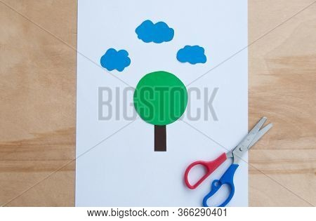 Making Postcard On A Summer Theme Diy. Tree On A White Background With Blue Clouds. Original Childre