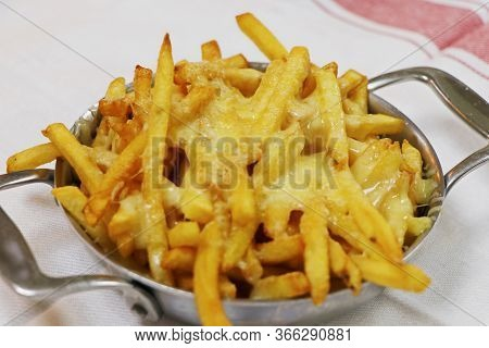 Golden Fried French Fries With Melted Cheddar Cheese, Known As Cheesy Fries