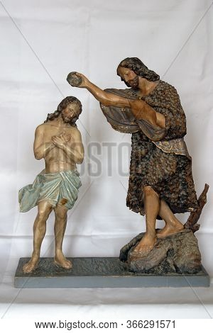 STITAR, CROATIA - SEPTEMBER 02, 2012: Baptism of the Lord, statue in Church of St. Matthew the Apostle and Evangelist in Stitar, Croatia