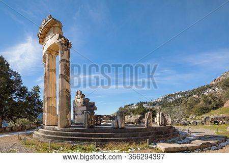 Ruins Of Athena Pronaia Temple In Delphi With Snow