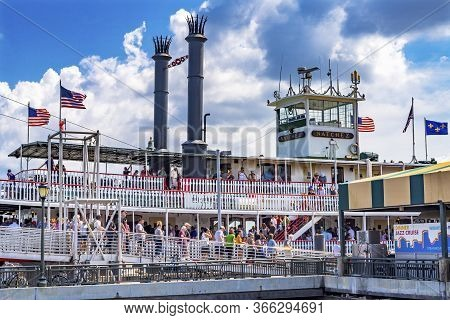 New Orleans, Louisiana, United States - October 6, 2019 Tourists Natchez Steamboat Riverboat Flags W